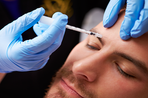 Botox injection in the forehead | Harley Street Dermatology Clinic